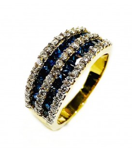 18 kts bicolor gold ring with blue sapphire and diamonds