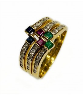 Combination of 3 rings with precious stones in gold of 18 kts