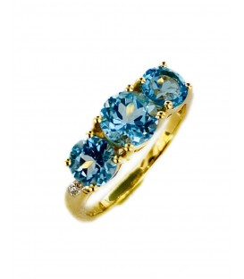 18 KTS GOLD RING WITH BLUE TOPAZ AND DIAMONDS