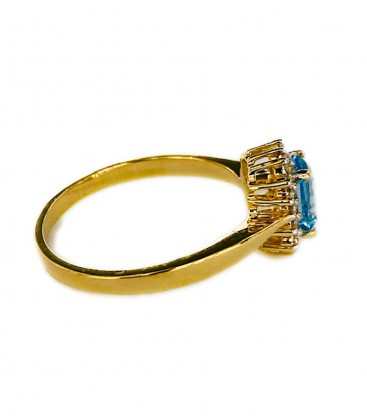 RING OF BLUE TOPAZ AND DIAMONDS